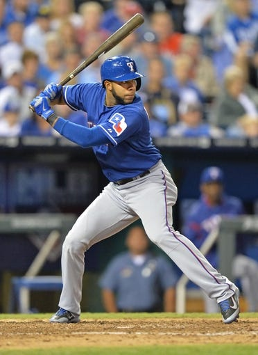 Sep 20, 2013; Kansas City, MO, USA; Texas Rangers shortstop Elvis Andrus (1) at bat against the Kansas City Royals during the third inning at Kauffman Stadium. Mandatory Credit: Peter G. Aiken-USA TODAY Sports