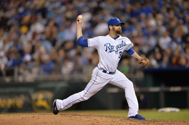 Sep 21, 2013; Kansas City, MO, USA; Kansas City Royals pitcher Louis Coleman (31) delivers a pitch against the Texas Rangers during the seventh inning at Kauffman Stadium. Mandatory Credit: Peter G. Aiken-USA TODAY Sports