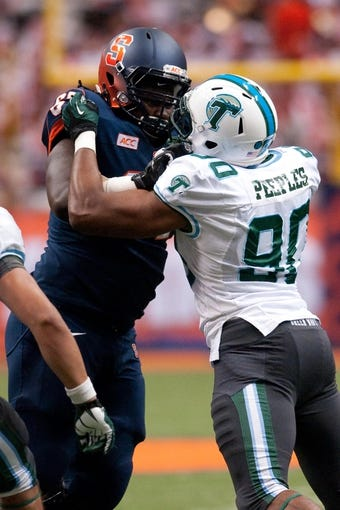 Sep 21, 2013; Syracuse, NY, USA; Syracuse Orange offensive linesman Michael Lasker (67) blocks Tulane Green Wave defensive end Jeremy Peeples (90) in the fourth quarter of a game at Carrier Dome. Syracuse won the game 52-17. Mandatory Credit: Mark Konezny-USA TODAY Sports