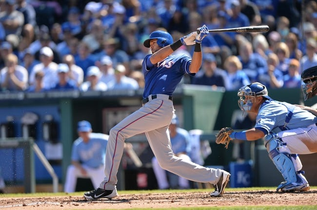 Sep 22, 2013; Kansas City, MO, USA; Texas Rangers right fielder Alex Rios (51) at bat against the Kansas City Royals during the third inning at Kauffman Stadium. Mandatory Credit: Peter G. Aiken-USA TODAY Sports