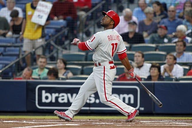 Sep 26, 2013; Atlanta, GA, USA; Philadelphia Phillies shortstop Jimmy Rollins (11) hits a single against the Atlanta Braves in the first inning at Turner Field. Mandatory Credit: Brett Davis-USA TODAY Sports