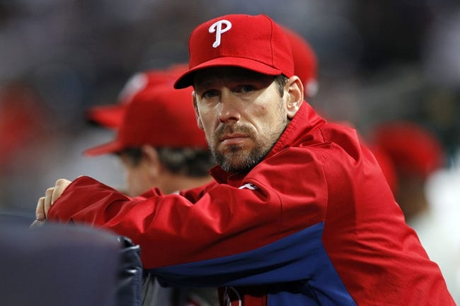 Sep 26, 2013; Atlanta, GA, USA; Philadelphia Phillies starting pitcher Cliff Lee (33) watches from the dugout against the Atlanta Braves in the first inning at Turner Field. Mandatory Credit: Brett Davis-USA TODAY Sports