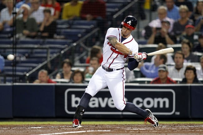 Sep 26, 2013; Atlanta, GA, USA; Atlanta Braves right fielder Jordan Schafer (17) hits a RBI single against the Philadelphia Phillies in the first inning at Turner Field. Mandatory Credit: Brett Davis-USA TODAY Sports