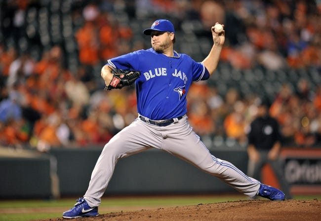 Sep 26, 2013; Baltimore, MD, USA; Toronto Blue Jays starting pitcher Mark Buehrle (56) throws in the first inning against the Baltimore Orioles at Oriole Park at Camden Yards. Mandatory Credit: Joy R. Absalon-USA TODAY Sports
