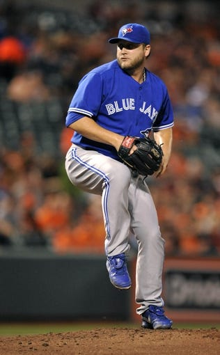 Sep 26, 2013; Baltimore, MD, USA; Toronto Blue Jays starting pitcher Mark Buehrle (56) throws in the second inning against the Baltimore Orioles at Oriole Park at Camden Yards. Mandatory Credit: Joy R. Absalon-USA TODAY Sports