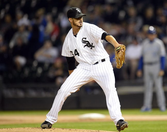 Sep 26, 2013; Chicago, IL, USA; Chicago White Sox starting pitcher Andre Rienzo (64) throws a pitch against the Kansas City Royals during the first inning at U.S Cellular Field. Mandatory Credit: Mike DiNovo-USA TODAY Sports