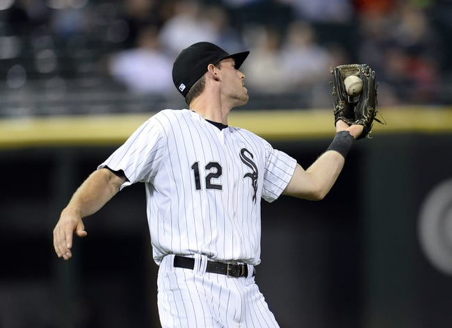 Sep 26, 2013; Chicago, IL, USA; Chicago White Sox third baseman Conor Gillaspie (12) makes a catch against the Kansas City Royals during the first inning at U.S Cellular Field. Mandatory Credit: Mike DiNovo-USA TODAY Sports