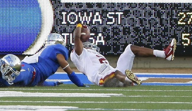 Sep 26, 2013; Tulsa, OK, USA; Iowa State Cyclones Aaron Wimberly (right) is tackled at the 1 yard line by Tulsa Golden Hurricane Dwight Dobbins (left) during the first half of a NCAA college football game at Skelly Field at H.A. Chapman Stadium. Mandatory Credit: Alonzo Adams-USA TODAY Sports