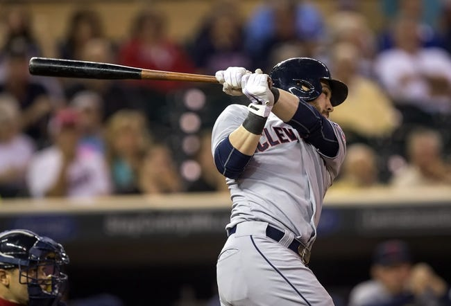 Sep 26, 2013; Minneapolis, MN, USA; Cleveland Indians second baseman Jason Kipnis (22) hits a double in the first inning against the Minnesota Twins at Target Field. Mandatory Credit: Jesse Johnson-USA TODAY Sports