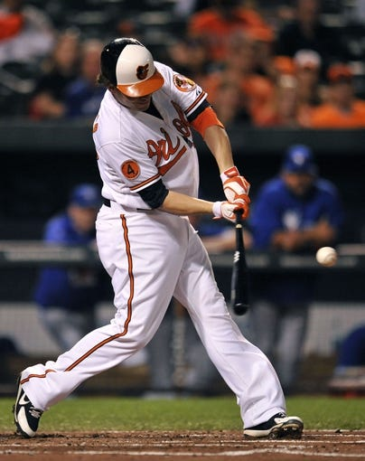 Sep 26, 2013; Baltimore, MD, USA; Baltimore Orioles designated hitter Danny Valencia (35) doubles in the first inning against the Toronto Blue Jays at Oriole Park at Camden Yards. Mandatory Credit: Joy R. Absalon-USA TODAY Sports