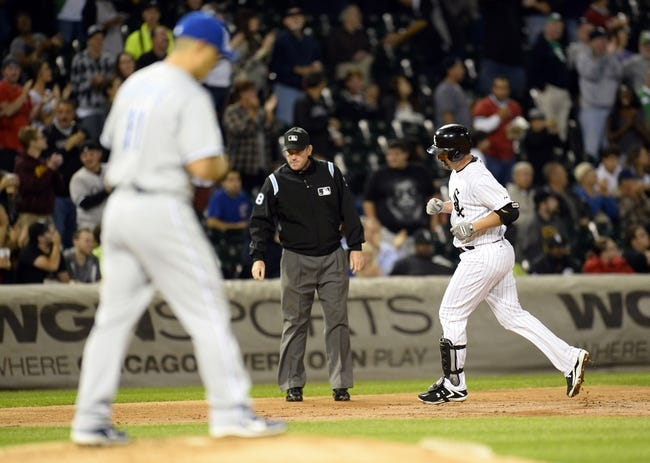 Sep 26, 2013; Chicago, IL, USA; Chicago White Sox first baseman Paul Konerko (14) runs after a solo home run against Kansas City Royals starting pitcher Jeremy Guthrie (11) during the second inning at U.S Cellular Field. Mandatory Credit: Mike DiNovo-USA TODAY Sports