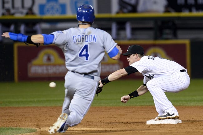 Sep 26, 2013; Chicago, IL, USA; Chicago White Sox second baseman Gordon Beckham (15) makes the force out against Kansas City Royals left fielder Alex Gordon (4) during the third inning at U.S Cellular Field. Mandatory Credit: Mike DiNovo-USA TODAY Sports