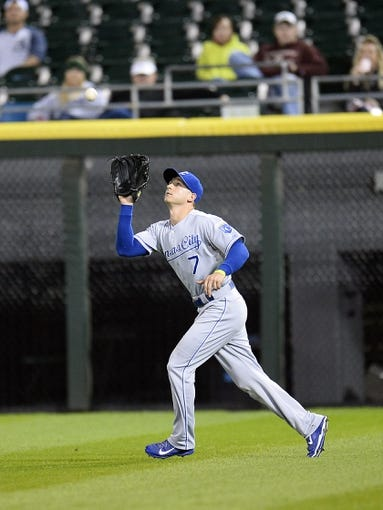 Sep 26, 2013; Chicago, IL, USA; Kansas City Royals right fielder David Lough (7) makes a catch against the Chicago White Sox during the third inning at U.S Cellular Field. Mandatory Credit: Mike DiNovo-USA TODAY Sports