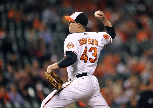 Sep 26, 2013; Baltimore, MD, USA; Baltimore Orioles pitcher Jim Johnson (43) throws in the ninth inning against the Toronto Blue Jays at Oriole Park at Camden Yards. The Orioles defeated the Blue Jays 3-2. Mandatory Credit: Joy R. Absalon-USA TODAY Sports
