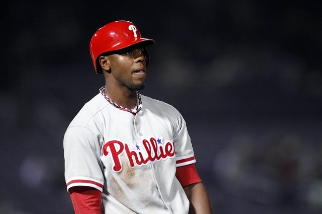 Sep 26, 2013; Atlanta, GA, USA; Philadelphia Phillies right fielder John Mayberry Jr. (15) reacts after being picked off first base against the Atlanta Braves in the seventh inning at Turner Field. Mandatory Credit: Brett Davis-USA TODAY Sports