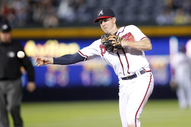 Sep 26, 2013; Atlanta, GA, USA; Atlanta Braves second baseman Elliot Johnson (30) throws a runner out at first against the Philadelphia Phillies in the ninth inning at Turner Field. The Braves defeated the Phillies 7-1. Mandatory Credit: Brett Davis-USA TODAY Sports