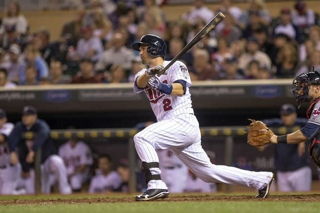 Sep 26, 2013; Minneapolis, MN, USA; Minnesota Twins second baseman Brian Dozier (2) hits a single in the fifth inning against the Cleveland Indians at Target Field. Mandatory Credit: Jesse Johnson-USA TODAY Sports