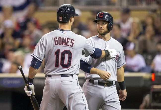 Sep 26, 2013; Minneapolis, MN, USA; Cleveland Indians catcher Yan Gomes (10) congratulates right fielder Ryan Raburn (9) after scoring a run in the fourth inning against the Minnesota Twins at Target Field. Mandatory Credit: Jesse Johnson-USA TODAY Sports