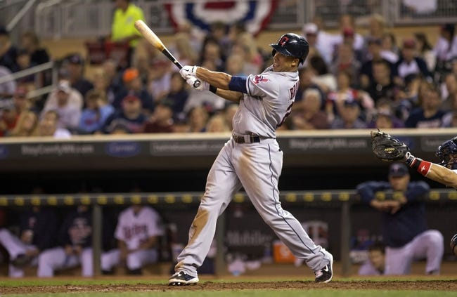 Sep 26, 2013; Minneapolis, MN, USA; Cleveland Indians left fielder Michael Brantley (23) hits a RBI single in the sixth inning against the Minnesota Twins at Target Field. Mandatory Credit: Jesse Johnson-USA TODAY Sports