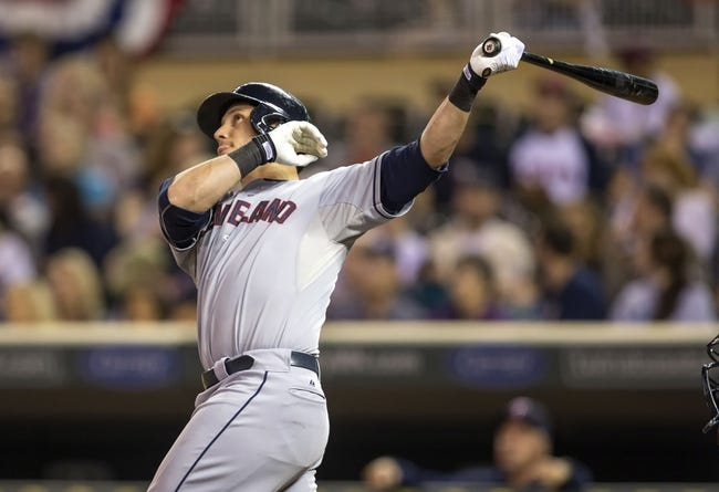 Sep 26, 2013; Minneapolis, MN, USA; Cleveland Indians catcher Yan Gomes (10) hits a two run home run in the fourth inning against the Minnesota Twins at Target Field. Mandatory Credit: Jesse Johnson-USA TODAY Sports
