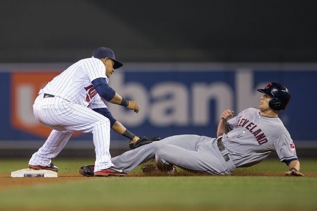 Sep 26, 2013; Minneapolis, MN, USA; Minnesota Twins shortstop Eduardo Escobar (5) tags out Cleveland Indians right fielder Drew Stubbs (11) for a double play in the fourth inning at Target Field. Mandatory Credit: Jesse Johnson-USA TODAY Sports
