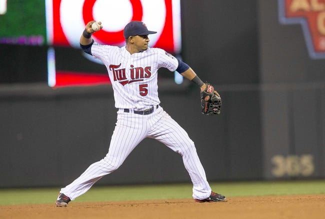 Sep 26, 2013; Minneapolis, MN, USA; Minnesota Twins shortstop Eduardo Escobar (5) throws the ball to first base in the fifth inning against the Cleveland Indians at Target Field. Mandatory Credit: Jesse Johnson-USA TODAY Sports