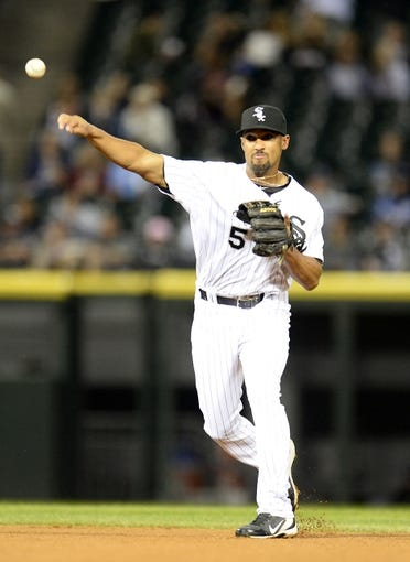 Sep 26, 2013; Chicago, IL, USA; Chicago White Sox shortstop Marcus Semien (5) makes a throw to first base against the Kansas City Royals during the eighth inning at U.S Cellular Field. Kansas City defeats Chicago 3-2. Mandatory Credit: Mike DiNovo-USA TODAY Sports