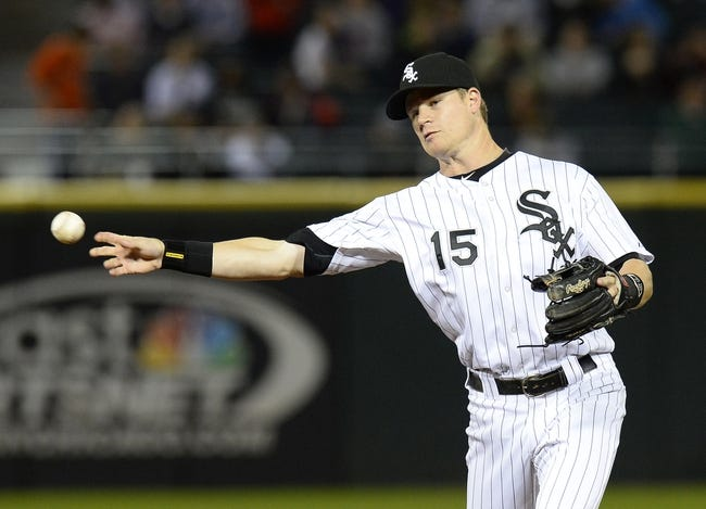 Sep 26, 2013; Chicago, IL, USA; Chicago White Sox second baseman Gordon Beckham (15) makes a throw to first base against the Kansas City Royals during the ninth inning at U.S Cellular Field. Kansas City defeats Chicago 3-2. Mandatory Credit: Mike DiNovo-USA TODAY Sports