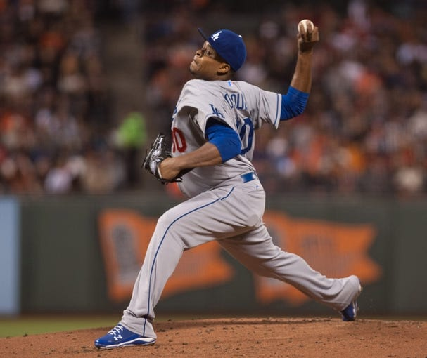 Sep 26, 2013; San Francisco, CA, USA; Los Angeles Dodgers starting pitcher Edinson Volquez (30) pitches against the San Francisco Giants during the first inning at AT&T Park. Mandatory Credit: Ed Szczepanski-USA TODAY Sports