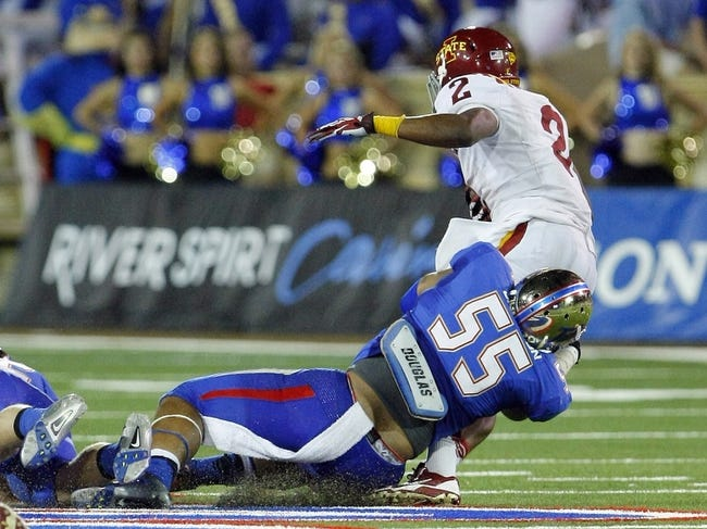 Sep 26, 2013; Tulsa, OK, USA; Tulsa Golden Hurricane Shawn Jackson (55) tackles Iowa State Cyclones running back Aaron Wimberly during the second of a NCAA college football game at Skelly Field at H.A. Chapman Stadium. Mandatory Credit: Alonzo Adams-USA TODAY Sports