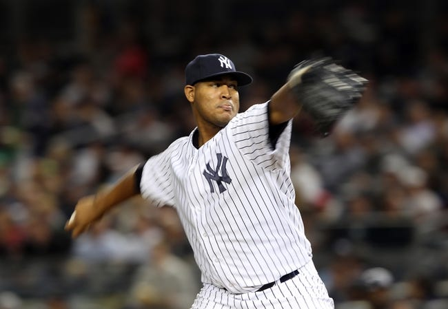 Sep 26, 2013; Bronx, NY, USA; New York Yankees starting pitcher Ivan Nova (47) pitches against the Tampa Bay Rays during the seventh inning of a game at Yankee Stadium. Mandatory Credit: Brad Penner-USA TODAY Sports