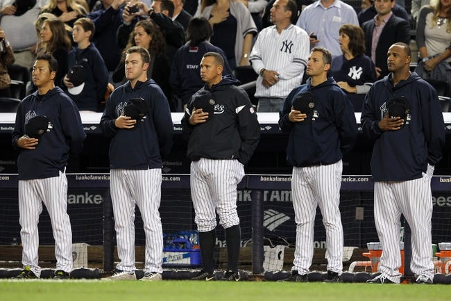 Sep 26, 2013; Bronx, NY, USA; New York Yankees starting pitcher Hiroki Kuroda (18) and starting pitcher Phil Hughes (65) and third baseman Alex Rodriguez (13) and starting pitcher Andy Pettitte (46) and starting pitcher CC Sabathia (52) stand for God Bless America during the seventh inning stretch of a game against the Tampa Bay Rays at Yankee Stadium. Mandatory Credit: Brad Penner-USA TODAY Sports