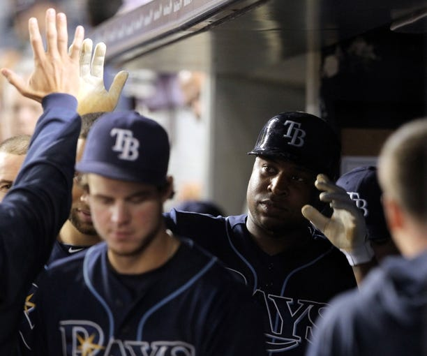 Sep 26, 2013; Bronx, NY, USA; Tampa Bay Rays designated hitter Delmon Young (15) is congratulated in the dugout after hitting a solo home run against the New York Yankees during the seventh inning of a game at Yankee Stadium. Mandatory Credit: Brad Penner-USA TODAY Sports
