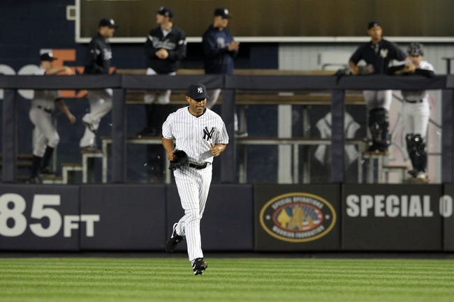 Sep 26, 2013; Bronx, NY, USA; New York Yankees relief pitcher Mariano Rivera (42) enters the game against the Tampa Bay Rays during the eighth inning of a game at Yankee Stadium. Mandatory Credit: Brad Penner-USA TODAY Sports
