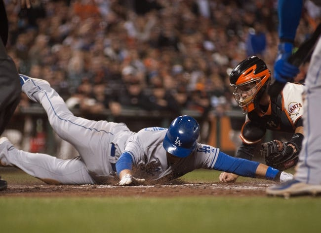 Sep 26, 2013; San Francisco, CA, USA; San Francisco Giants catcher Buster Posey (28, right) tags out Los Angeles Dodgers catcher Tim Federowicz (18, left) as he slides into home plate during the second inning at AT&T Park. Mandatory Credit: Ed Szczepanski-USA TODAY Sports