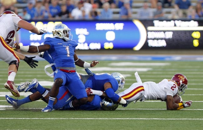 Sep 26, 2013; Tulsa, OK, USA; Iowa State Cyclones running back Aaron Wimberly (2) is tackled by Tulsa Golden Hurricane during the second half against the Iowa State Cyclones at Skelly Field at H.A. Chapman Stadium. Mandatory Credit: Alonzo Adams-USA TODAY Sports