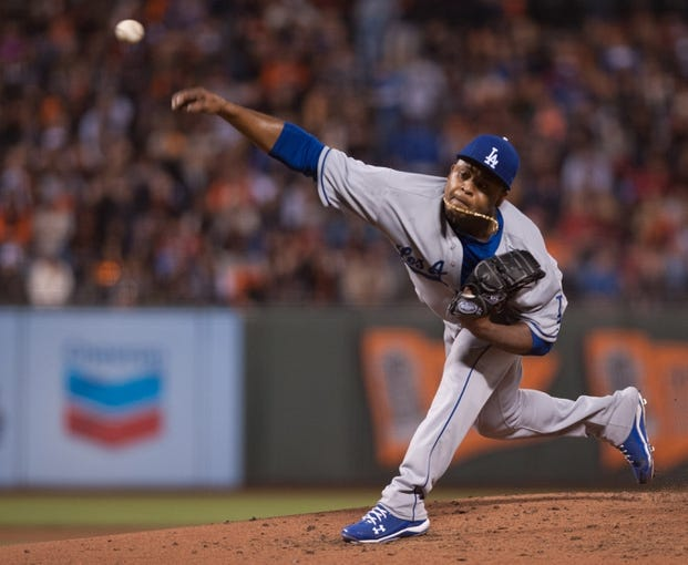 Sep 26, 2013; San Francisco, CA, USA; Los Angeles Dodgers relief pitcher Edinson Volquez (30) pitches against the San Francisco Giants during the second inning at AT&T Park. Mandatory Credit: Ed Szczepanski-USA TODAY Sports
