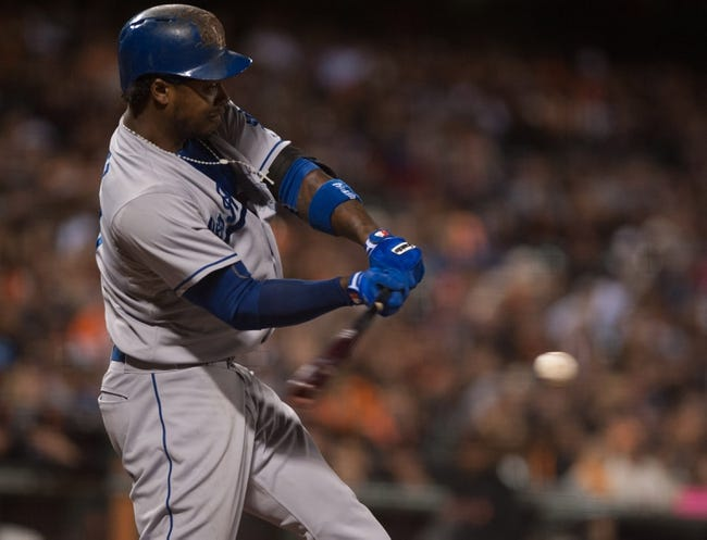 Sep 26, 2013; San Francisco, CA, USA; Los Angeles Dodgers shortstop Hanley Ramirez (13) hits a single against the San Francisco Giants during the third inning at AT&T Park. Mandatory Credit: Ed Szczepanski-USA TODAY Sports