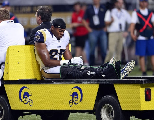 Sep 26, 2013; St. Louis, MO, USA; St. Louis Rams strong safety T.J. McDonald (25) is carted off of the field with a leg injury during the second half against the San Francisco 49ers at the Edward Jones Dome. The 49ers defeated the Rams 35-11. Mandatory Credit: Scott Rovak-USA TODAY Sports