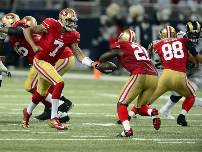 Sep 26, 2013; St. Louis, MO, USA; San Francisco 49ers quarterback Colin Kaepernick (7) hands off to running back Frank Gore (21) for a 34 yard touchdown during the first half against the St. Louis Rams at the Edward Jones Dome. San Francisco defeated St. Louis 35-11. Mandatory Credit: Jeff Curry-USA TODAY Sports