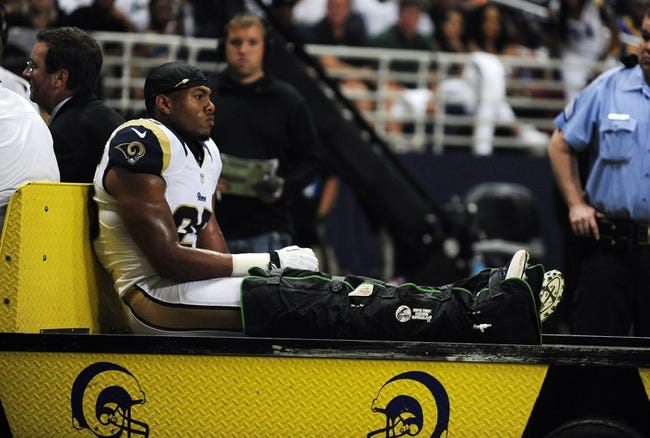 Sep 26, 2013; St. Louis, MO, USA; St. Louis Rams strong safety T.J. McDonald (25) is taken off the field after breaking his leg during the second half against the San Francisco 49ers at the Edward Jones Dome. San Francisco defeated St. Louis 35-11. Mandatory Credit: Jeff Curry-USA TODAY Sports