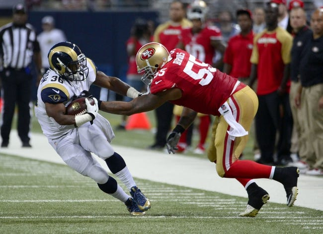 Sep 26, 2013; St. Louis, MO, USA; St. Louis Rams running back Benny Cunningham (36) avoids a tackle attempt by San Francisco 49ers outside linebacker Ahmad Brooks (55) during the second half at the Edward Jones Dome. The 49ers defeated the Rams 35-11. Mandatory Credit: Scott Rovak-USA TODAY Sports