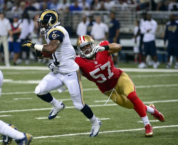 Sep 26, 2013; St. Louis, MO, USA; San Francisco 49ers linebacker Michael Wilhoite (57) tackles St. Louis Rams wide receiver Tavon Austin (11) during the second half at the Edward Jones Dome. The 49ers defeated the Rams 35-11. Mandatory Credit: Scott Rovak-USA TODAY Sports