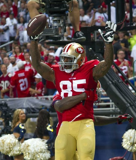 Sep 26, 2013; St. Louis, MO, USA; San Francisco 49ers tight end Vernon Davis (85) celebrates his touchdown against the St. Louis Rams during the second half at the Edward Jones Dome. The 49ers defeated the Rams 35-11. Mandatory Credit: Scott Rovak-USA TODAY Sports