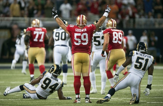 Sep 26, 2013; St. Louis, MO, USA; San Francisco 49ers center Jonathan Goodwin (59) celebrates a 34 yard touchdown run by running back Frank Gore (not pictured) as St. Louis Rams defensive end Robert Quinn (94) and outside linebacker Will Witherspoon (51) look on during the first half at the Edward Jones Dome. San Francisco defeated St. Louis 35-11. Mandatory Credit: Jeff Curry-USA TODAY Sports