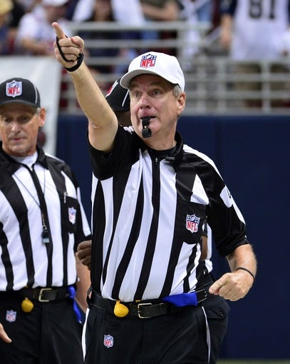 Sep 26, 2013; St. Louis, MO, USA; NFL referee Jeff Triplette signals St. Louis Rams first down during the second half of the game against the San Francisco 49ers at the Edward Jones Dome. The 49ers defeated the Rams 35-11. Mandatory Credit: Scott Rovak-USA TODAY Sports