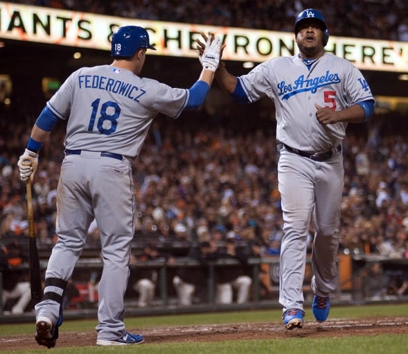 Sep 26, 2013; San Francisco, CA, USA; Los Angeles Dodgers catcher Tim Federowicz (18) congratulates third baseman Juan Uribe (5) after he scored against the San Francisco Giants during the fourth inning at AT&T Park. The San Francisco Giants defeated the Los Angeles Dodgers 3-2. Mandatory Credit: Ed Szczepanski-USA TODAY Sports