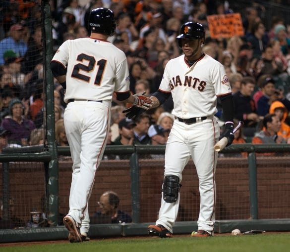 Sep 26, 2013; San Francisco, CA, USA; San Francisco Giants second baseman Nick Noonan (21) is congratulated by center fielder Gregor Blanco (7) after scoring against the Los Angeles Dodgers during the fifth inning at AT&T Park. The San Francisco Giants defeated the Los Angeles Dodgers 3-2. Mandatory Credit: Ed Szczepanski-USA TODAY Sports