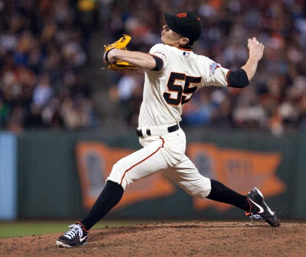 Sep 26, 2013; San Francisco, CA, USA; San Francisco Giants starting pitcher Tim Lincecum (55) pitches against the Los Angeles Dodgers during the seventh inning at AT&T Park. The San Francisco Giants defeated the Los Angeles Dodgers 3-2. Mandatory Credit: Ed Szczepanski-USA TODAY Sports