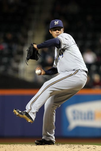 Sep 27, 2013; New York, NY, USA; Milwaukee Brewers starting pitcher Yovani Gallardo (49) pitches against the New York Mets during the first inning of a game at Citi Field. Mandatory Credit: Brad Penner-USA TODAY Sports